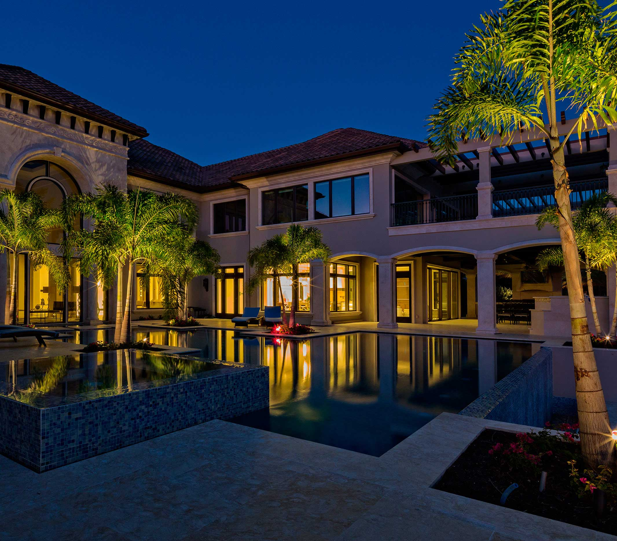 Picture of outdoor landscape lighting around a pool area of Naples home